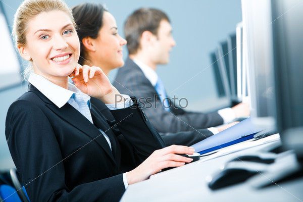 Portrait of friendly smiling woman looking at camera during business training