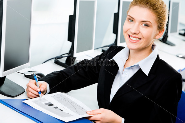 Portrait of pretty business woman holding a pen and document in the classroom