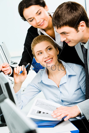 Portrait of three business people working together in the classroom