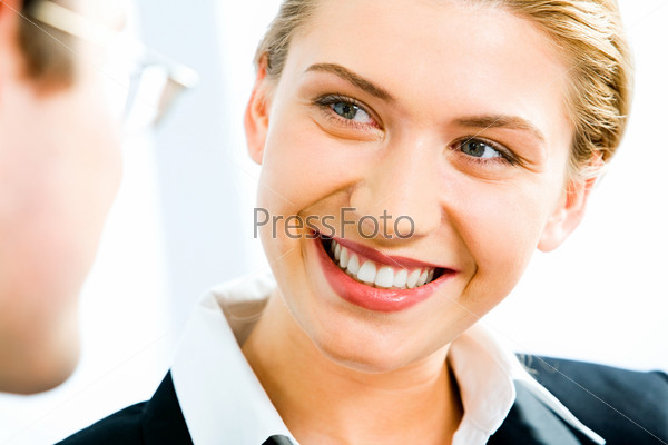 Portrait of young smiling  woman gazing at business man