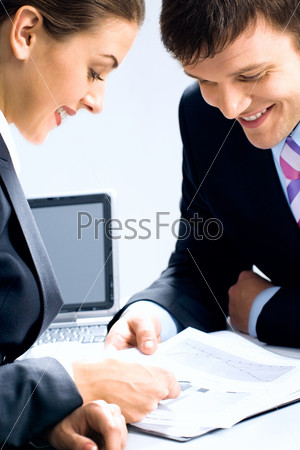 Two business people looking at business-plan and discussing it