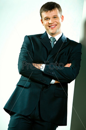 Business man folds his arms isolated on a white background