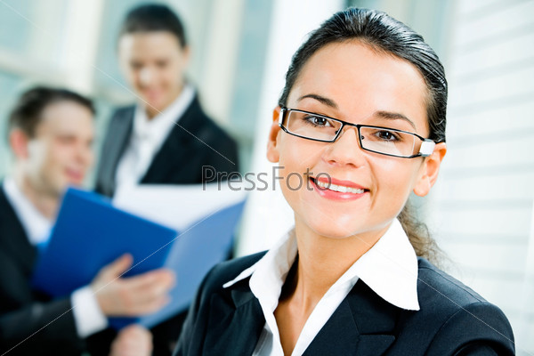 Portrait of successful entrepreneur with glasses on the background of people