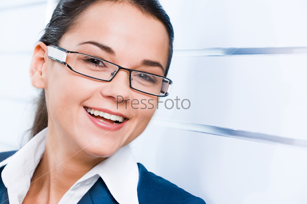 Face of business woman with smile isolated on a white background