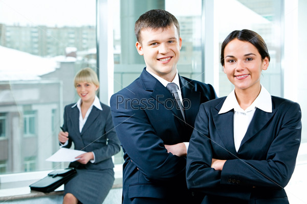 Portrait of two business people folding one\'s arms in the office