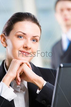 Beautiful business woman with pen in her hand isolated on a white background
