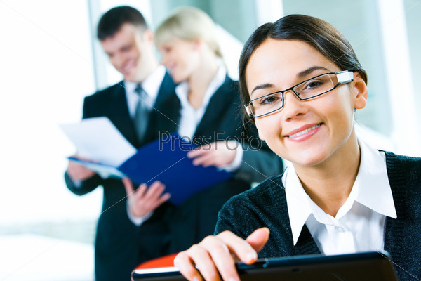 Image of clever woman looking at camera on the background of people