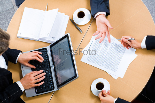 Photo of businesspeople's hands on the table