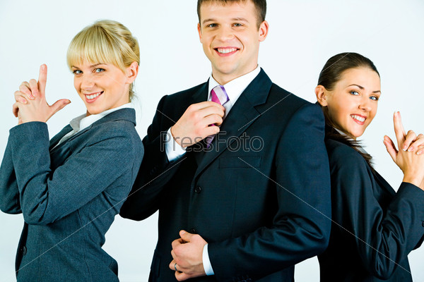 Portrait of smiling businessman between two businesswomen