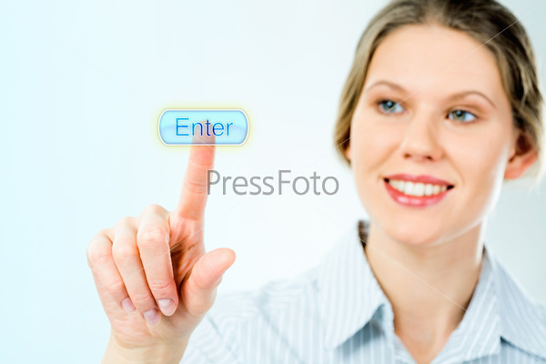 Portrait of businesswoman pressing enter button