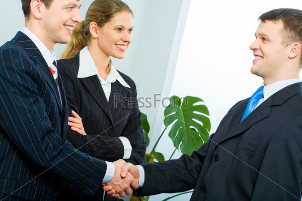 Handshake of two successful partners at business meeting