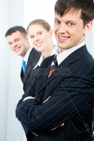 Row of successful business team with leader in front