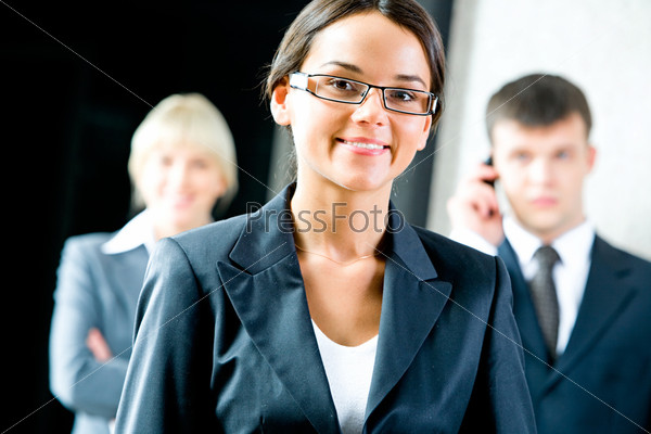 Portrait of beautiful employee with glasses