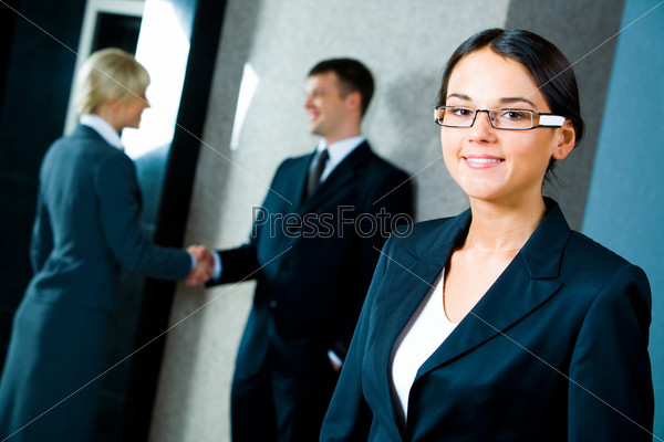Image of confident businesswoman wearing glasses in the office