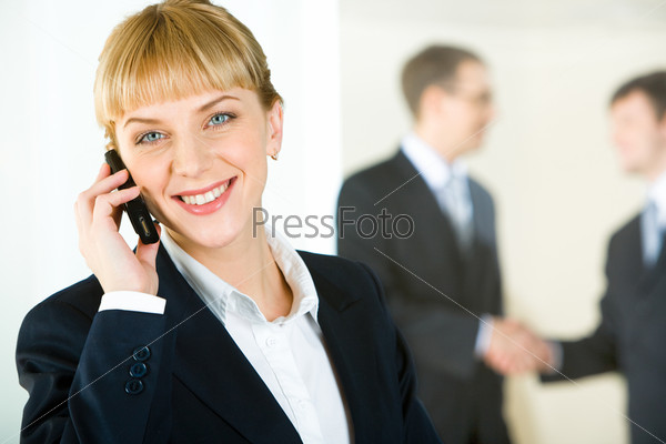 Portrait of beautiful business woman calling on the telephone