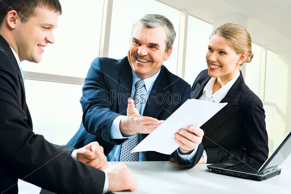 Image of senior boss giving business instructions to man and pretty secretary
