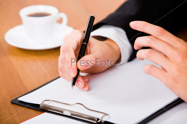 Photo of businesswoman's hands before writing a business contract