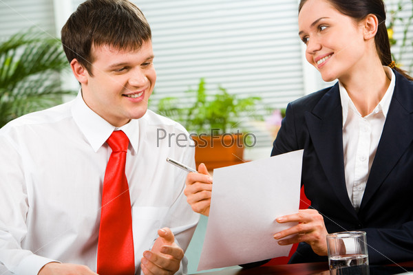 Image of pretty business woman giving the pen and paper to man