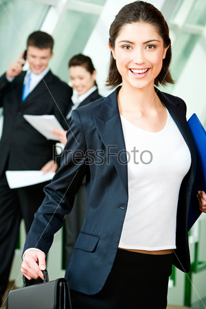 Image of happy woman holding folder and briefcase