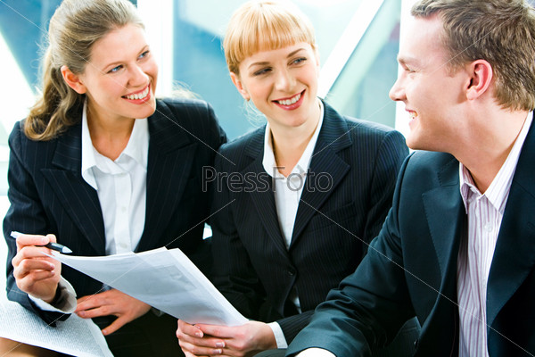 Team of three business people discussing a new project