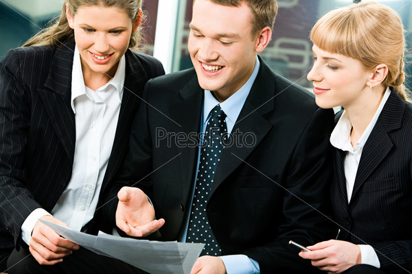 Portrait of confident business man showing his project to colleagues at meeting
