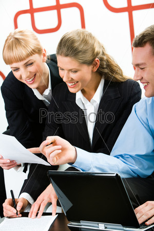 Vertical image of three business people working together