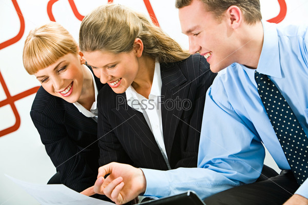 Image of business team looking at document and discussing it