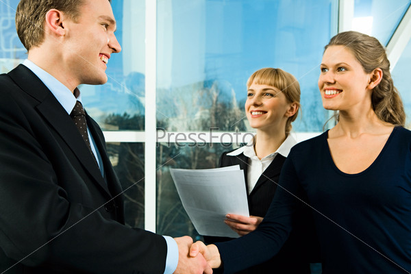 Successful handshake of confident business people making a deal