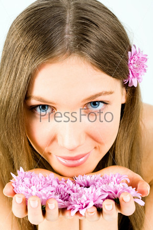 Image of beautiful woman holding the violet flowers