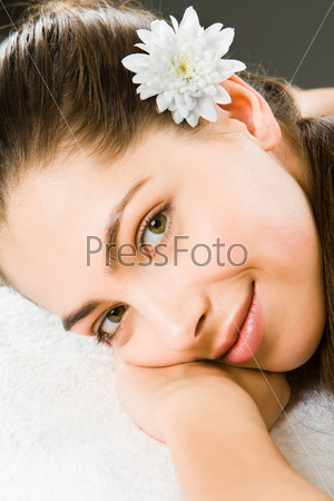 Beautiful smiling woman putting head on her hand