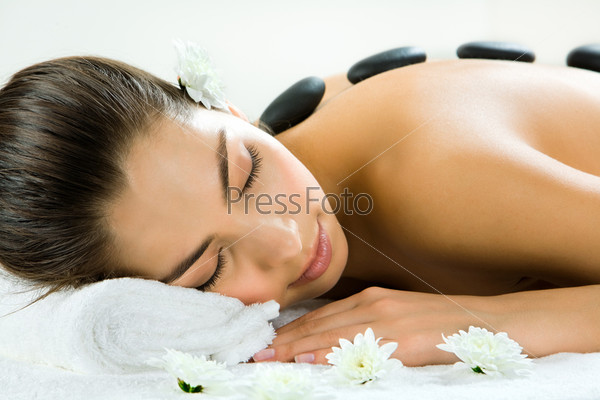 Portrait of beautiful woman sleeping during a stone massage