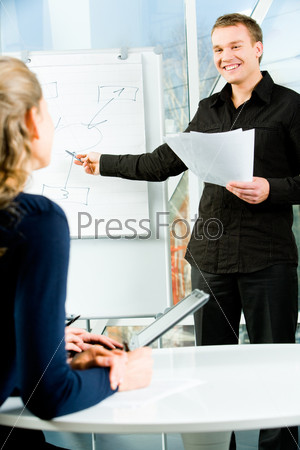 Image of confident professional explaining his project to people