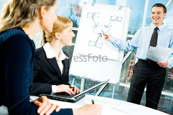 Photo of confident speaker giving a presentation at business meeting