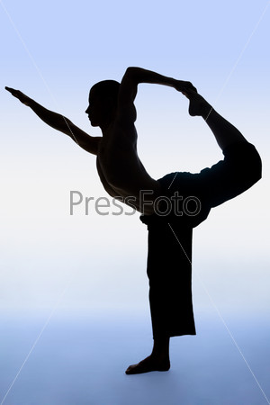 Man is doing an expert yoga exercise on a blue background