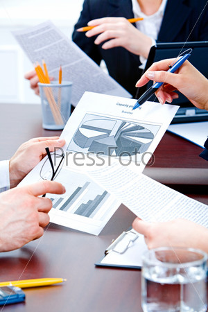 Photo of businesspeople's hands while a work