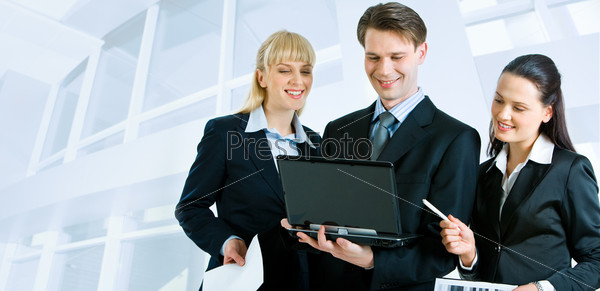 Successful businesspeople looking at the laptop screen