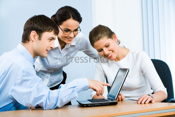Photo of businessman demonstrating a computer work to women