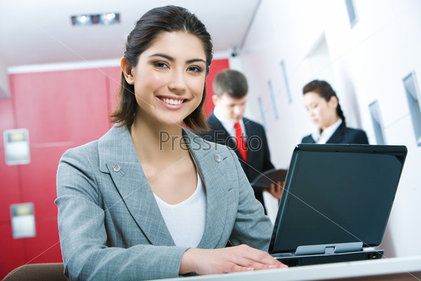 Image of pretty business woman looking at camera
