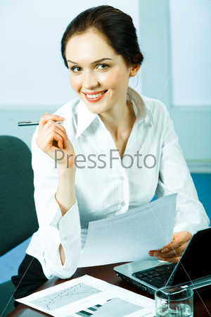 Young elegant business woman holding paper and pen