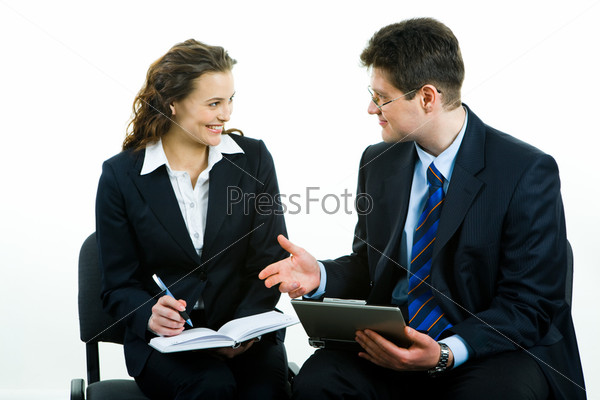Business man giving a working advice to young woman