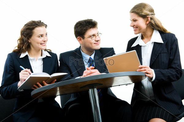 Image of two people looking at business woman at meeting