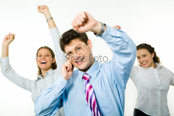 Portrait of happy business people raising hands