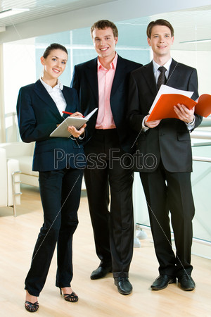 Vertical photo of business team standing in the office