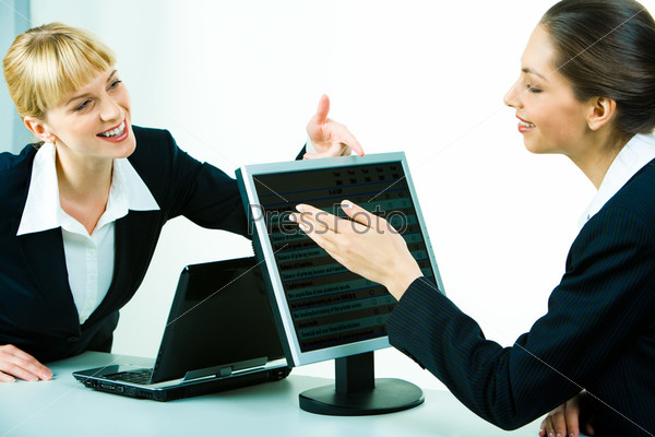Portrait of two business women chatting at work