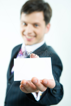 View of visiting card in business man's hand