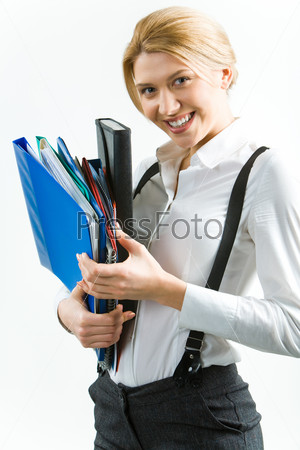 Portrait of attractive smiling student holding the folders