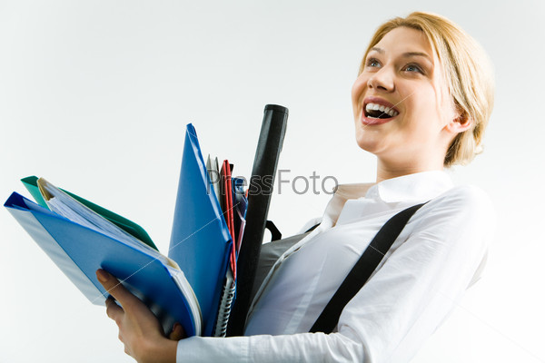 Pretty student holding the folders and laughing