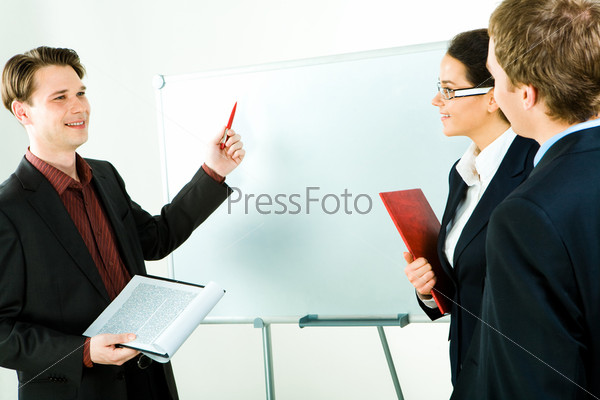 Portrait of business man telling about new strategy of company to the partners