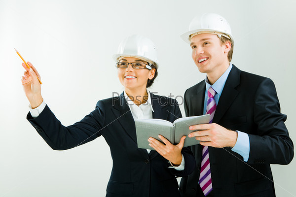 Image of business woman raising her hand with worker standing near by