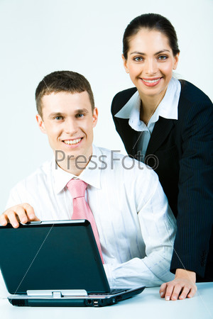 Portrait of two smiling employees looking at camera